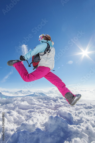 Hiker in winter Caucasus mountains