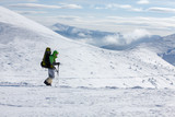 Hiker walking in winter Carpathian mountains