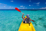 Caucasian man kayaking in sea at Maldives