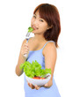 Young Asian woman with a bowl of vegetable salad