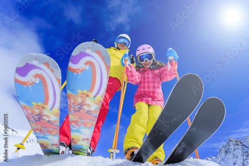 Ski, winter fun - skiers enjoying ski vacation - 56613155