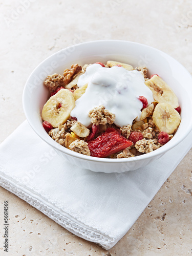 Granola with dried fruits and yogurt in a bowl