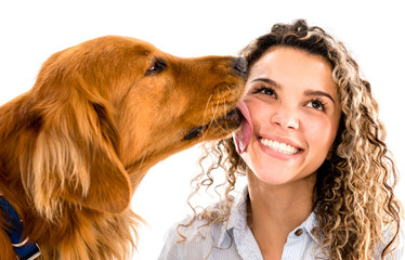 Dog licking womans face