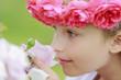 Rose garden - cute girl playing in the rose garden