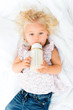 Baby girl drinking from a bottle