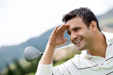 Golf player looking away