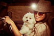 girl and dog in car
