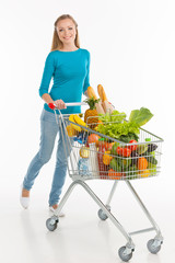 Shopaholic. Cheerful young woman carrying shopping cart