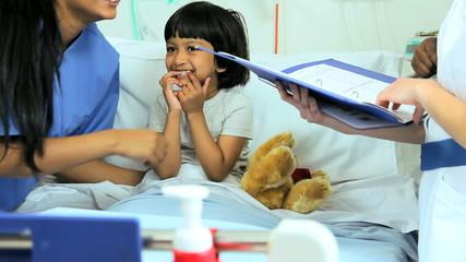Little Ethnic Girl Hospital Patient Multi Ethnic Nurses