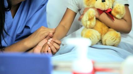 Female Ethnic Children's Nurse Young Girl Hospital  Bed
