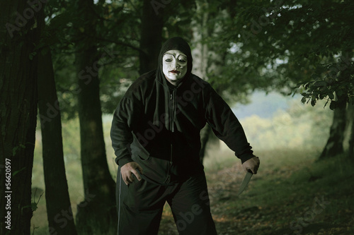 Masked mad man with a knife