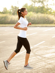 Athletic Runner Training in  a park for Marathon. Fitness Girl R