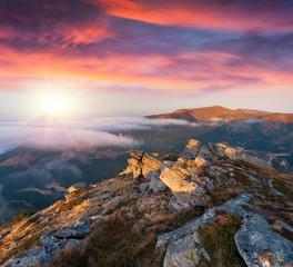 Colorful autumn sunrise in the Carpathian mountains.