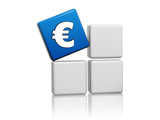 euro sign in blue cube on grey boxes