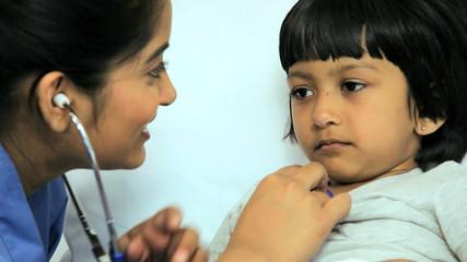 Ethnic Nursing Staff Treating Child Patient Close Up