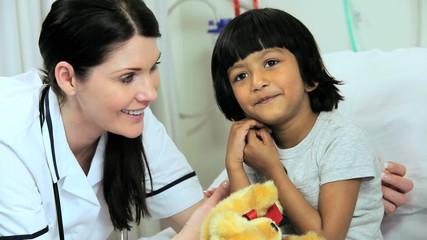 Caucasian Specialist Nursing Staff Treating Child Patient