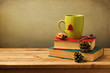 Christmas tea mug on books on wooden table