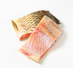 Raw carp fillets
