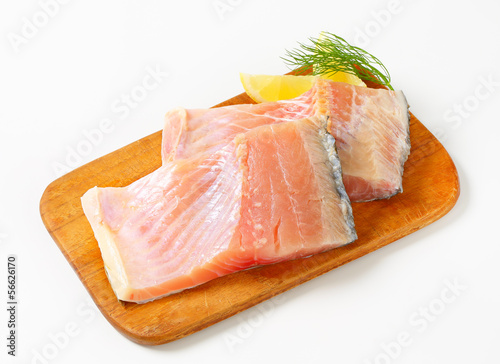 Raw carp fillets
