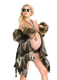 Blond pregnant woman in fur coat