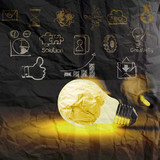light bulb 3d on business strategy on crumpled paper background