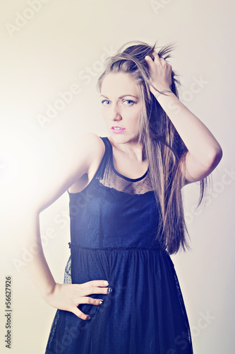 Attractive young woman wearing modern black dress