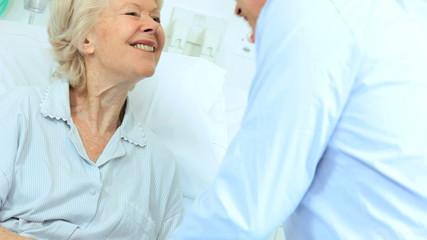 Male Relative Visiting Mature Lady Hospital Ward