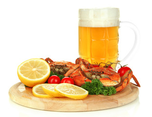 Boiled crabs with lemon slices and tomatoes,
