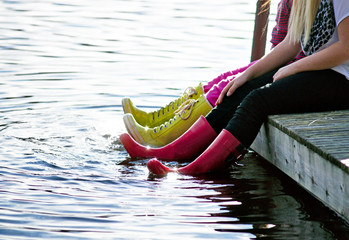 girls with feet in water
