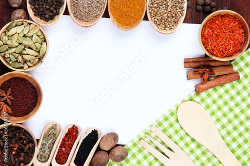 Various spices and herbs with empty white blank for recipe