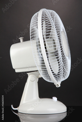 Electric fan on grey background
