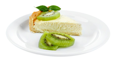 Slice of cheesecake with kiwi fruit on plate, isolated on white