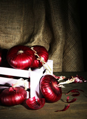 Fresh red onions in cellar
