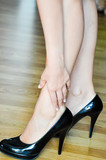 woman heel or ankle pain