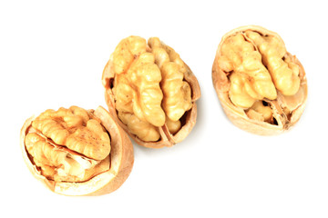 Broken walnuts isolated on white
