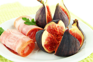 Tasty figs with ham, close up
