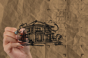 hand drawing house with wrinkled recycle paper