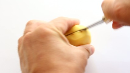 Men's hands cut peel potato,  metal knife.