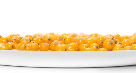 The plate of sea-buckthorn berries