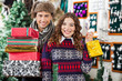 Happy Young Couple In Christmas Store