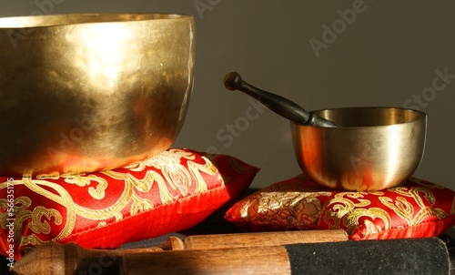 Singin bowl on a gallant gold/red pillow