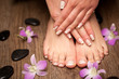Leinwanddruck Bild - Relaxing pink manicure and pedicure with a orchid flower