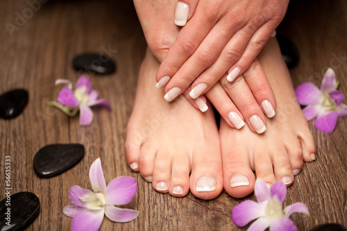 Leinwanddruck Bild Relaxing pink manicure and pedicure with a orchid flower