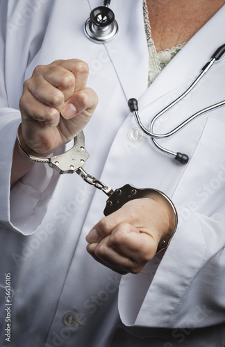 Doctor or Nurse In Handcuffs Wearing Lab Coat and Stethoscope