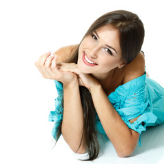 Beautiful teen girl lying in blue dress  and smiling