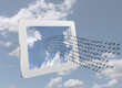Binary data stream and tablet over sky - computing concept