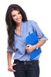 casual woman smiles with clipboard in hand