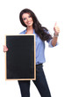 casual woman with blackboard shows thumb up