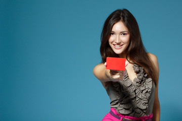 beautiful teen girl showing red card in hand
