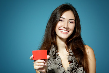 beautiful friendly smiling confident girl showing red card in ha